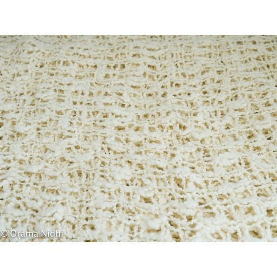 Poncho ivoire crocheté