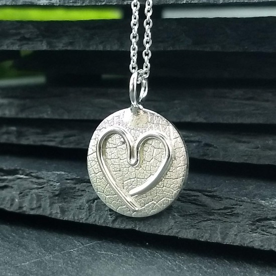 Pendentif Coeur d'enfant en argent
